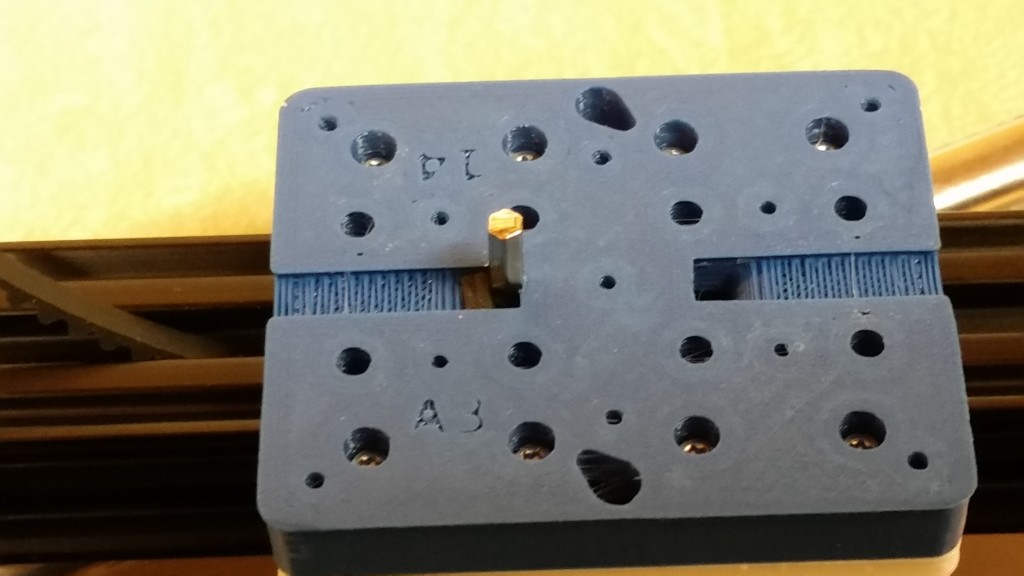 Here one of the allen wrenches included in the kit is pushing the belt up through the hole.